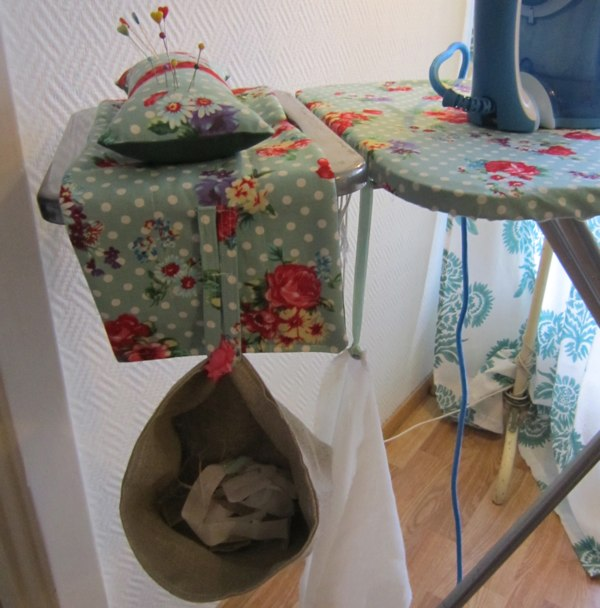 Ironing board caddy with pincushion
